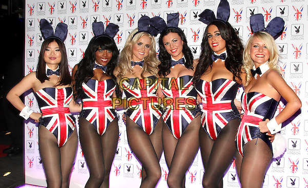 Playboy Bunnies .At the opening of the Playboy Club, Old Park Lane, Mayfair, London, England, UK, June 4th 2011..half  length bunny ears union jack costume hands on hips tights bow ties cuffs .CAP/ROS.©Steve Ross/Capital Pictures