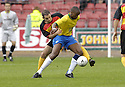 01/09/2007       Copyright Pic: James Stewart.File Name : sct_jspa14_partick_v_hamilton.RICHARD OFFIONG HOLDS OFF A CHALLENGE.James Stewart Photo Agency 19 Carronlea Drive, Falkirk. FK2 8DN      Vat Reg No. 607 6932 25.Office     : +44 (0)1324 570906     .Mobile   : +44 (0)7721 416997.Fax         : +44 (0)1324 570906.E-mail  :  jim@jspa.co.uk.If you require further information then contact Jim Stewart on any of the numbers above........