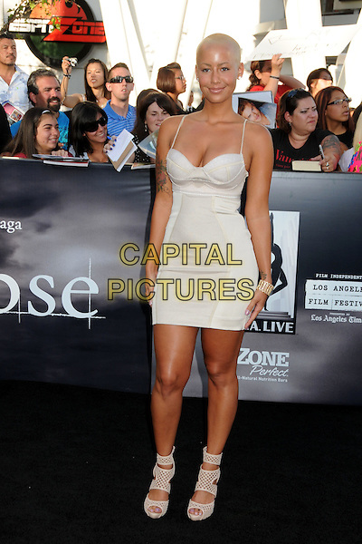 "AMBER ROSE .""The Twilight Saga: Eclipse"" Los Angeles Premiere at the 2010 Los Angeles Film Festival held at Nokia Theatre LA Live, Los Angeles, California, USA, 24th June 2010..full length dress shaved hair head cleavage earrings bustier white cream open peep toe strappy sandals .CAP/ADM/BP.©Byron Purvis/AdMedia/Capital Pictures."