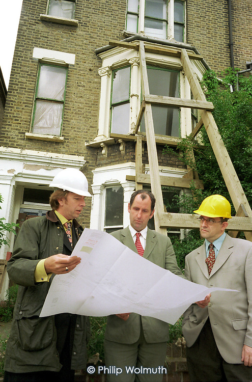Camden Council staff survey an unsafe empty residential property.