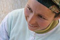 A portrait of a smiling Moroccan woman in a headscarf, near Sefrou, Morocco.