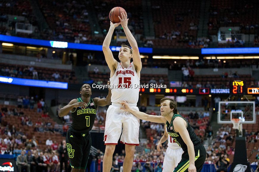 Wisconsin Badgers forward Sam Dekker (15) shoots the ball during  a regional semifinal NCAA college basketball tournament game against the Baylor Bears Thursday, March 27, 2014 in Anaheim, California. The Badgers won 69-52. (Photo by David Stluka)