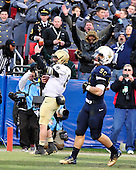 United States Army Black Knight quarterback Trent Steelman (8) celebrates as he scores a touchdown against the U.S. Navy Midshipmen in the 112th meeting of the two teams at FedEx Field in Landover, Maryland on Saturday, December 10, 2011.  Navy outside linebacker Brye French (50) follows on the play.  The Navy won the game 27 - 21..Credit: Ron Sachs / CNP