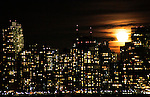 A full moon rises over the skyline lower Manhattan in New York, 9/01/12. New York City, with a population of over 8.1 million, is the most populous city in the United States. It is known for its status as a financial, cultural, transportation, and manufacturing center, and for its history as a gateway for immigration to the United States.   Photo by Kena Betancur / VIEWpress.