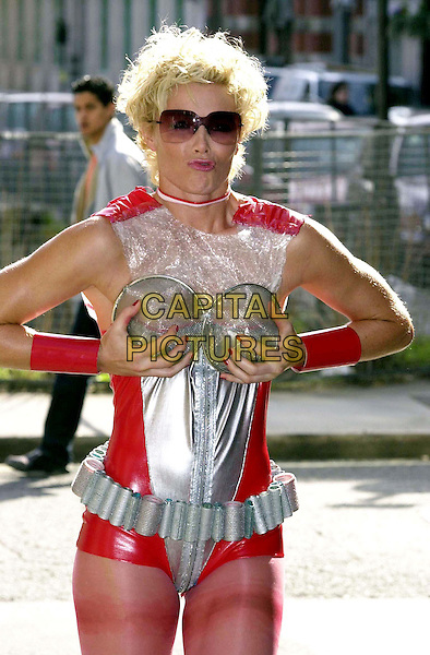 "NELL McANDREW (former ""Tomb Raider"" girl) ..At Cancer Research UK/Dylon Recycled Fashion Show ..At the American Intercontinental University..grabbing breasts, fondling, sunglasses, shades, half length, half-length..www.capitalpictures.com..sales@capitalpictures.com..©Capital Pictures"