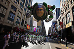People take part of the annual Thanksgiving day parade with a Buzz's balloon in New York, November 22, 2012. . Photo by Eduardo Munoz Alvarez / VIEW.