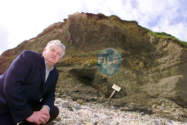 Cllr Tom Kelly neeling under part of the exposed over hang at Ben Head.Picture Fran Caffrey Newsfile...This Picture is sent to you by:..Newsfile Ltd.The View, Millmount Abbey, Drogheda, Co Louth, Ireland..Tel: +353419871240.Fax: +353419871260.GSM: +353862500958.ISDN: +353419871010.email: pictures@newsfile.ie.www.newsfile.ie