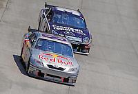 Jun 1, 2008; Dover, DE, USA; NASCAR Sprint Cup Series driver A.J. Allmendinger (84) leads David Gilliland (38) during the Best Buy 400 at the Dover International Speedway. Mandatory Credit: Mark J. Rebilas-US PRESSWIRE