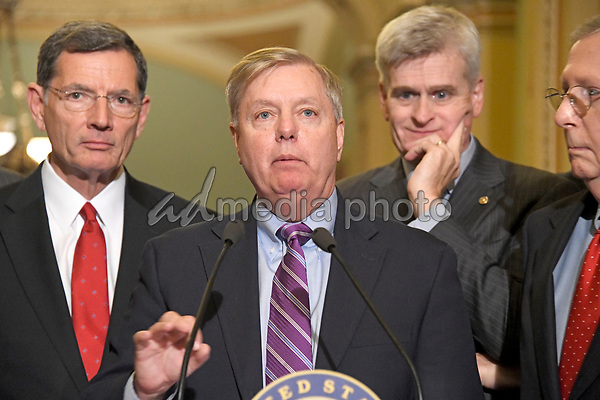 United States Senator Lindsey Graham (Republican of South Carolina) speaks to reporters outside the US Senate Chamber following the Republican weekly luncheon caucus in the US Capitol in Washington, DC on Tuesday, September 19, 2017.  The GOP leadership is advocating for the passage of the Graham-Cassidy Act that would replace parts of the Affordable Care Act (also known as ObamaCare) with block grants for the individual states.  From left to right: US Senator John Barrasso (Republican of Wyoming), Senator Graham, US Senator Bill Cassidy (Republican of Louisiana) and US Senate Majority Leader Mitch McConnell (Republican of Kentucky). Photo Credit: Ron Sachs/CNP/AdMedia