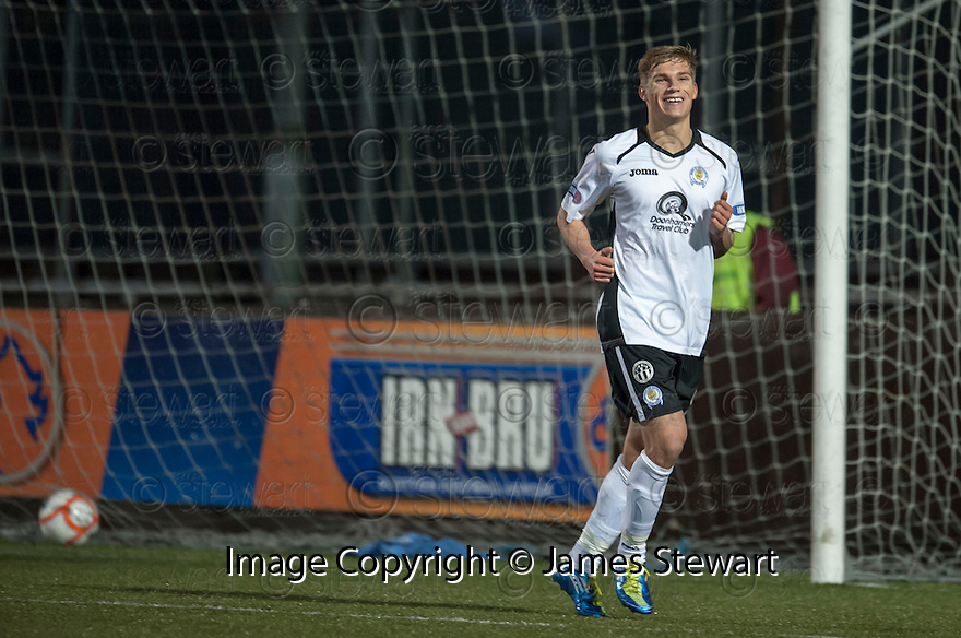 Queen of the South's Kevin Holt celebrates after he scores their third goal.