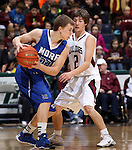 SIOUX FALLS, SD - MARCH 21:  Matthew Eastmo #22 from St. Thomas More looks for room to drive past Preston Nordling #2 from Madison in the first half of their Class A Boys semifinal game Friday evening at the Sioux Falls Arena. (Photo by Dave Eggen/Inertia)