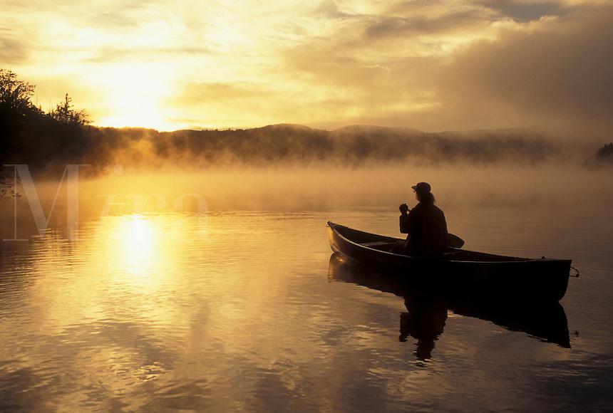 sunrise, canoeing, sunset, canoe, Vermont, VT, Woman paddling a canoe on Mollys Falls Pond at sunrise in the mist.