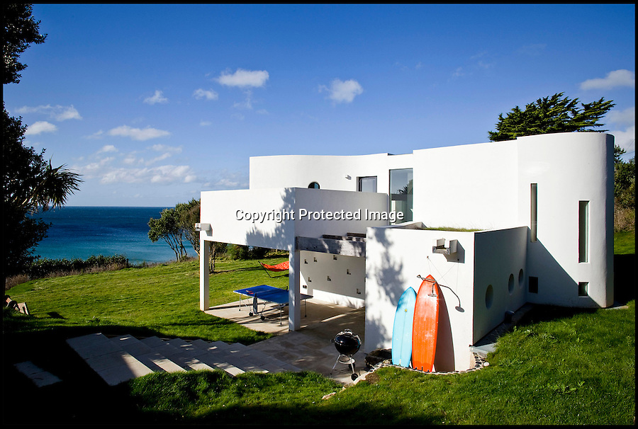 BNPS.co.uk (01202 558833)<br /> Pic: ForeverCornwall/BNPS<br /> <br /> ****Must use full byline****<br /> <br /> The cottage now.<br /> <br /> When a couple paid out £500,000 for a tumbledown cottage that was fit for nothing but demolition, a few eyebrows were raised among their friends.<br /> <br /> But Alex Michaelis and Susanna Bell's gamble to buy the cliff-top property that had no central heating or electricity has paid off after they turned it into a stunning holiday home now worth three times the purchase price.<br /> <br /> Architect Alex made the most of the stunning views enjoyed from the plot and has ensured all main rooms of the new house, including the four bedrooms and five bathrooms, face the sea.<br /> <br /> They now rent out the modern seaside home overlooking Praa Sands, near Penzance, Cornwall for as much as £5,000 a week.