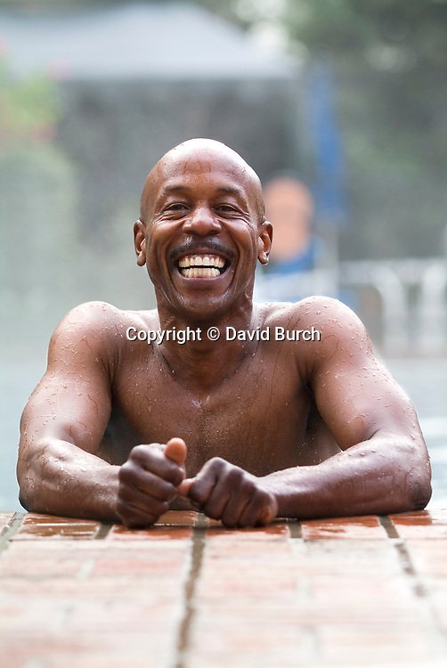 Man smiling in swimming pool, portrait