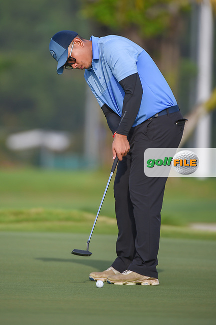Vanseiha SENG (CAM) watches his putt on 1 during Rd 1 of the Asia-Pacific Amateur Championship, Sentosa Golf Club, Singapore. 10/4/2018.<br /> Picture: Golffile | Ken Murray<br /> <br /> <br /> All photo usage must carry mandatory copyright credit (© Golffile | Ken Murray)