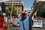 Anti-austerity demonstrators hold placards during a protest in central Athens. Greek Prime Minister Alexis Tsipras faced a revolt in his left-wing party and workers' calls for strikes ahead of Wednesday's Parliament vote on a bailout deal meant to prevent the country's economy from collapsing.