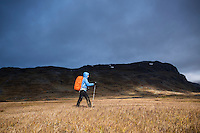 Dramatic stormy light on female hiker in Alisvagge along kungsleden Trail, Lappland, Sweden