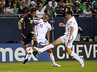 Costa Rica's Jhonny Acosta (right) blocks a shot by Mexico's Giovani dos Santos as Costa Rica's Junior Diaz (15) applies pressure from behind.  Mexico defeated Costa Rica 4-1 at the 2011 CONCACAF Gold Cup at Soldier Field in Chicago, IL on June 12, 2011.