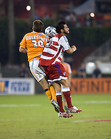 FC Dallas forward Carlos Ruiz (20) battles Houston Dynamo defender Richard Mulrooney (30) for the ball.  Houston Dynamo defeated FC Dallas 4-1 at Robertson Stadium in Houston, TX on November 2, 2007.  Houston Dynamo won the Western Conference semifinal series with an aggregate score of 4-2.