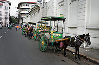 Philippines, Manila, 5 march, 2008..Traditional horse taxi in Cabildo Street in Intramuros the oldest district of the city of Manila...Traditionele paarden taxi in Intramuros, het oudste district van Manila, de hoofdstad van de Filippijnen...Photo Kees Metselaar