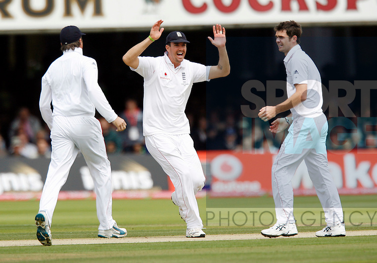 England's Kevin Pietersen celebrates with James Anderson as Ricky Ponting goes for 4