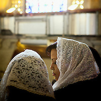 Egypt / Cairo / 4.11.2012 / Coptic women during the Papal election ceremony in St Mark Cathedral in Abbasseya. Pope Theodoros II or Tawadros II was selected as the 118th pope. © Giulia Marchi