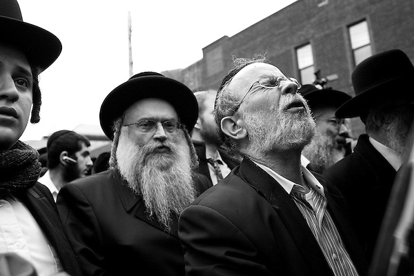 Wednesday, April 18,  2007, Brooklyn, New York..A funeral was held in Brooklyn for Professor Librescu, a holocaust survivor and teacher at Virginia Tech, who was killed in the shootings on Monday.. Mourners prayed at the rear of the car that transported the boy to the airport for its trip to Israel for burial.