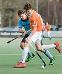 WASSENAAR - Hoofdklasse hockey heren, HGC-Bloemendaal (0-5).  Florian Fuchs (Bldaal) met  Weigert Schut (HGC)     COPYRIGHT KOEN SUYK