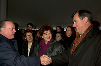 Montreal, Dec 3rd, 2001<br /> <br /> Quebec Premier Bernard Landry (L), shake hands with previous Quebec Premier ; Lucien Bouchard (R) while Quebec State Minister for Culture and Communications ; Diane Lemieux M) smiles,<br /> at the official launch of the new Quebec Library's (Grande Bibliothcque du Qu&raquo;bec  )construction on Berri street in Montreal, CANADA, Monday december 3rd, 2001.<br /> <br /> (Photo by Pierre Roussel - Images Distribution)