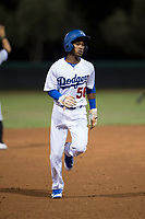AZL Dodgers shortstop Albert Suarez (56) hustles towards third base during an Arizona League game against the AZL White Sox at Camelback Ranch on July 3, 2018 in Glendale, Arizona. The AZL Dodgers defeated the AZL White Sox by a score of 10-5. (Zachary Lucy/Four Seam Images)