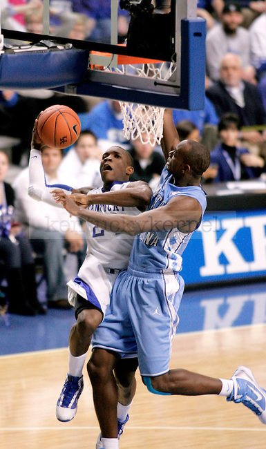 Freshman Eric Bledsoe goes in for two points for the Cats near the end of the second half of their game against UNC on Saturday, Dec. 05, 2009 at Rupp Arena. UK beat UNC 68-66.