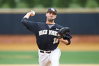 Wake Forest Demon Deacons relief pitcher Aaron Fossas (18) in action against the Florida State Seminoles at Wake Forest Baseball Park on April 19, 2014 in Winston-Salem, North Carolina.  The Seminoles defeated the Demon Deacons 4-3 in 13 innings.  (Brian Westerholt/Four Seam Images)