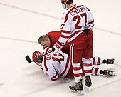 Larry Venis (BU - Assistant Director-Athletic Training Services) checks on Jakob Forsbacka Karlsson (BU - 23). - The visiting Merrimack College Warriors defeated the Boston University Terriers 4-1 to complete a regular season sweep on Friday, January 27, 2017, at Agganis Arena in Boston, Massachusetts.The visiting Merrimack College Warriors defeated the Boston University Terriers 4-1 to complete a regular season sweep on Friday, January 27, 2017, at Agganis Arena in Boston, Massachusetts.