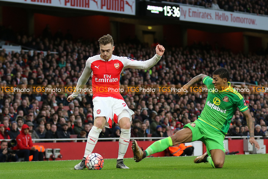 Calum Chambers of Arsenal crosses the ball as Sunderland's Patrick Van Aanholt challenges for the ball during Arsenal vs Sunderland AFC at the Emirates Stadium