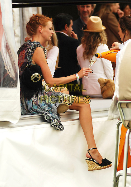 OLIVIA INGE .At the Veuve Clicquot Cup Final 2008 in.Midhurst, England, July 20th 2008..full length Matthew Williamson butterfly wing print black dress profile cigarette smoking bag sitting wedges .CAP/TTL .©TTL/Capital Pictures