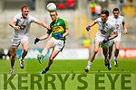 Colm Cooper, Kerry in action against Tommy Moolick,  and Kevin Murnaghan, Kildare in the All Ireland Quarter Final at Croke Park on Sunday.