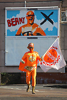 Pictured: Captain Beany -aka Barry Kirk- at his political party's billboard at the back of the Red Lion pub in his hometown of Port Talbot, south Wales. <br /> Pictured: Captain Beany in his museum.<br /> Re: Captain Beany (aka Barry Kirk) founder of the first Bean Museum of Excellence in a council flat in Port Talbot, south Wales.<br /> Caped crusader Captain Beaney has converted his welsh flat home into a historical tribute to the humble baked bean.<br /> The museum is made up of collectibles and artefacts Captain Beaney has acquired over the years.
