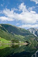 reflection of mountains in Naeroyfjord, Gudvangen, Norway