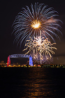 """""""Celebrating Independence Day""""<br /> <br /> Duluth, Minnesota puts on a grand fireworks display over the harbor each Independence Day. The ample Lake Superior shoreline and hillsides give viewers many choices for prime vantage points. To top it off, the Aerial Lift Bridge is specially lit in red, white, and blue just this one night. It is spectacular!"""