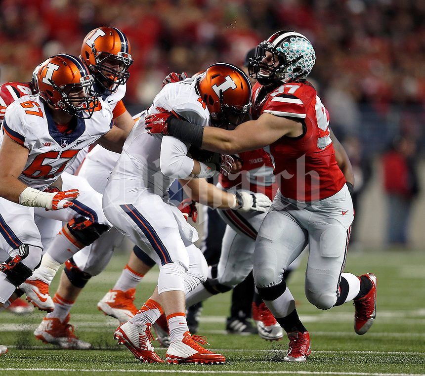 Ohio State Buckeyes defensive lineman Joey Bosa (97) gets ready to bring down Illinois Fighting Illini quarterback Reilly O'Toole (4) in the first quarter of the NCAA football game at Ohio Stadium on Saturday, November 1, 2014. (Columbus Dispatch photo by Jonathan Quilter)