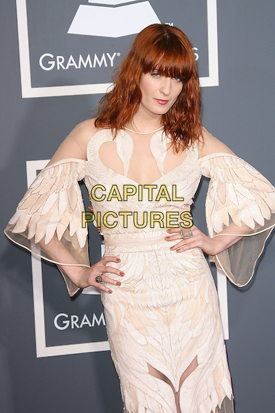 FLORENCE WELCH (Florence and the Machine).The 53rd Annual GRAMMY Awards held at the Staples Center, Los Angeles, California, USA..February 13th, 2011.arrivals grammys half length cream dress nude sheer sleeves see thru through hands on hips.CAP/ADM.©AdMedia/Capital Pictures.