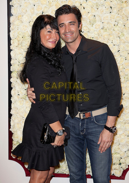 "Gilles Marini & his Mom.QVC Presents ""The Buzz On The Red Carpet"" held at The Four Seasons Hotel, Beverly Hills, California, USA, .23rd February 2012 .half length mother son family black shirt .CAP/ADM/ES.©Emiley Schweich/AdMedia/Capital Pictures."