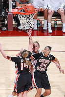STANFORD, CA - January 7, 2012: Stanford Cardinal's Joslyn Tinkle watches Nnemkadi Ogwumike's 2000th career point during Stanford's 67-60 victory over Oregon State at Maples Pavilion in Stanford, California.