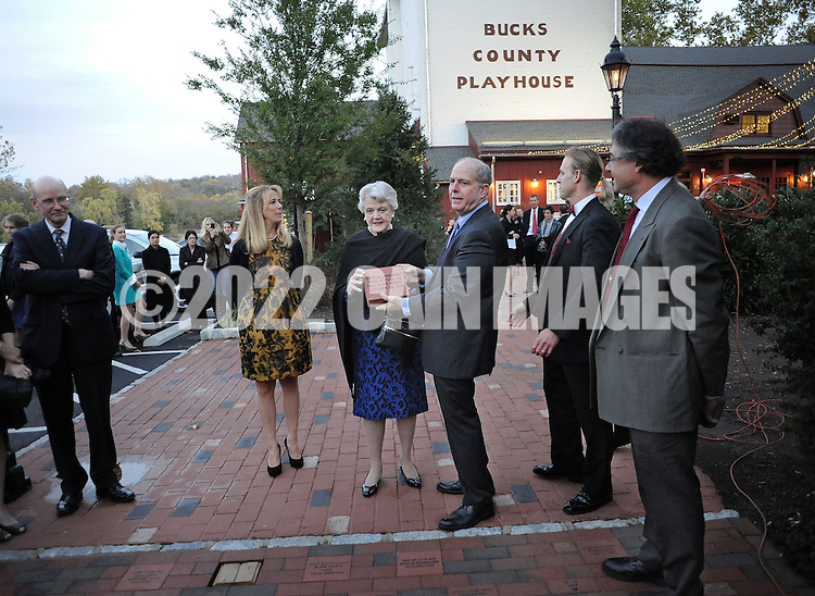 NEW HOPE, PA -  OCTOBER 28: Actress Angela Lansbury (C) is presented with a commemorative brick to be installed in the walkway by Jed Bernstein (right of center), Producing Director of the Bucks County Playhouse October 28, 2013 at the Bucks County Playhouse in New Hope, Pennsylvania.  Lansbury,  five-time Tony Award winning actress is the first inductee of the Bucks County Playhouse's Hall of Fame.(Photo by William Thomas Cain/Cain Images)