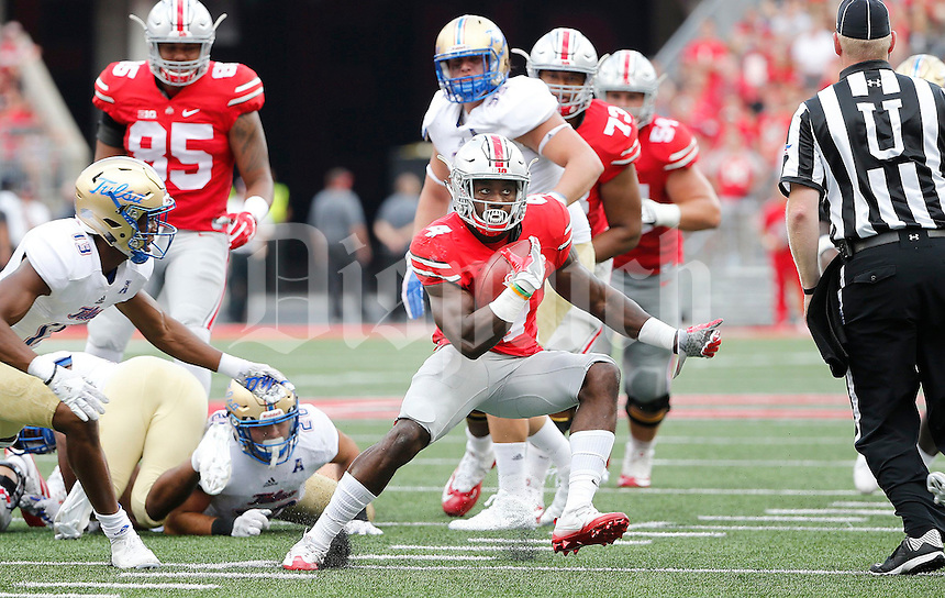 Ohio State Buckeyes running back Curtis Samuel (4) runs during the second quarter of the NCAA football game between the Ohio State Buckeyes and the Tulsa Golden Hurricane at Ohio Stadium on Saturday, September 10, 2016. (Columbus Dispatch photo by Jonathan Quilter)