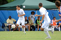 2 October 2011:  FIU midfielder/forward Mario Uribe (17) moves the ball downfield in the first half as the FIU Golden Panthers defeated the University of Kentucky Wildcats, 1-0 in overtime, at University Park Stadium in Miami, Florida.