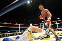 Takashi Uchiyama (JPN),..DECEMBER 31, 2011 - Boxing :..Takashi Uchiyama of Japan knocks out Jorge Solis of Mexico in the eleventh round during the WBA super featherweight title bout at Yokohama Cultural Gymnasium in Kanagawa, Japan. (Photo by Hiroaki Yamaguchi/AFLO)