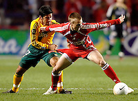 Chicago Fire forward Chris Rolfe (17) holds off LA Galaxy midfielder Paulo Nagamura (17).  The Chicago Fire defeated the Los Angeles Galaxy 3-1 in the championship game of the U.S. Open Cup at Toyota Park in Bridgeview, IL on September 27, 2006...