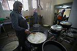 Palestinian volunteers prepare donated food for Iftar (the evening meal during the Islamic month of Ramadan), during the holy fasting month of Ramadan, in the West Bank city of Nablus on June 21, 2015. During Ramadan, Muslim believers abstain from eating, drinking, smoking and having sex from dawn until sunset. Ramadan is sacred to Muslims because it is during that month that tradition says the Koran was revealed to the Prophet Mohammed. The fast is one of the five main religious obligations under Islam. Photo by Ahmad Talat