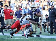 Annapolis, MD - September 23, 2017: Navy Midshipmen running back Malcolm Perry (10) gets tackled during the game between Cincinnati and Navy at  Navy-Marine Corps Memorial Stadium in Annapolis, MD.   (Photo by Elliott Brown/Media Images International)